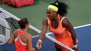 Serena Williams greets Roberta Vinci at the net.