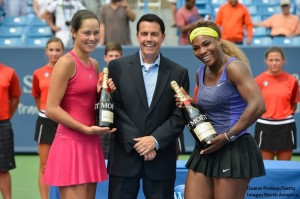 Ana Ivanovic and Serena Williams are joined by Vince Cicero in the trophy ceremony at the Western and Southern Open