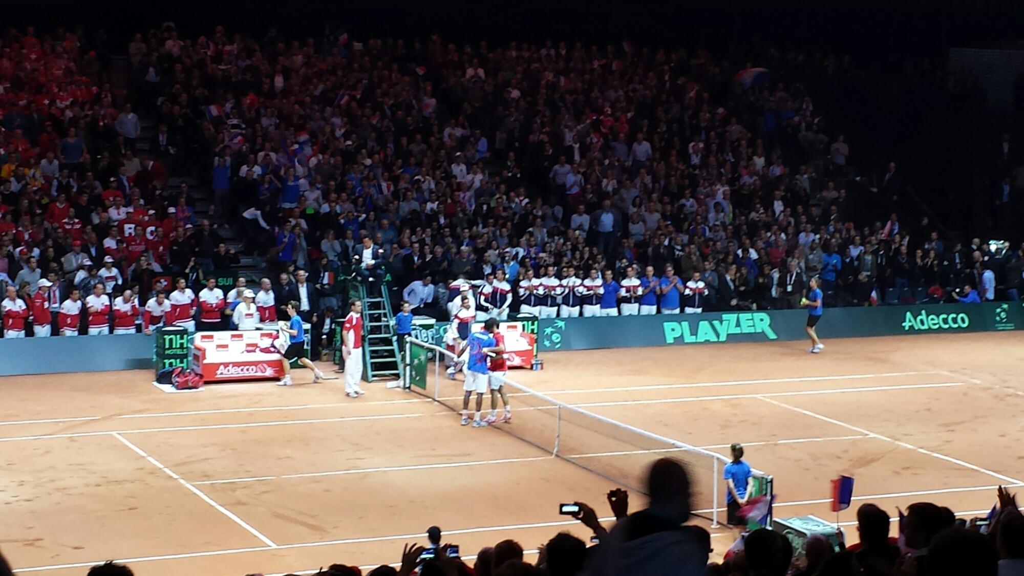 Federer Monfils Embrace